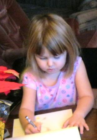 J drawing at table